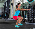 Air squat woman exercise at gym - PhotoDune Item for Sale