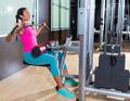 Lat pulldown machine woman workout at gym - PhotoDune Item for Sale