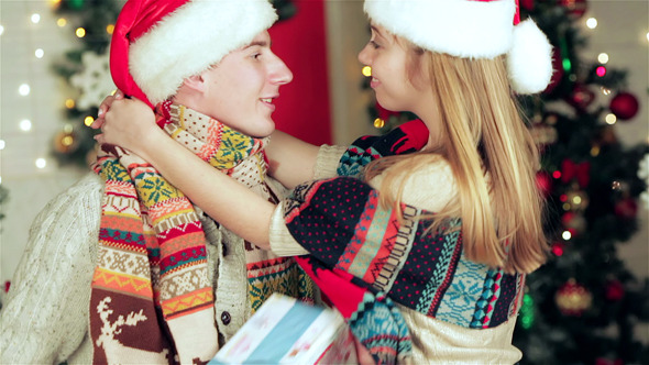 Loving Couple Hold Christmas Presents