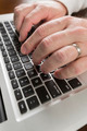 Male Hands Typing on Laptop Computer Keyboard. - PhotoDune Item for Sale