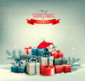 Holiday Christmas background with gift boxes and a santa hat.  - PhotoDune Item for Sale
