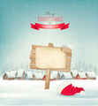 Holiday Christmas background with a village and a sign. - PhotoDune Item for Sale
