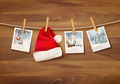 Holiday background with christmas photos and a santa hat.  - PhotoDune Item for Sale