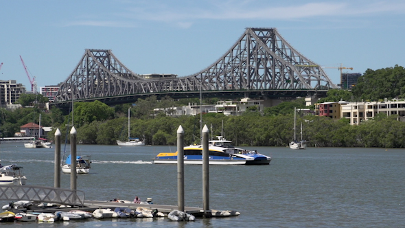 Ferry In Front Of The Story Bridge In Brisbane