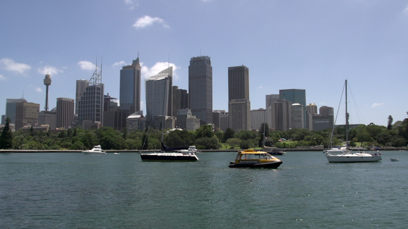 VideoHive Sail Boats And Small Water Taxi In Front Of Sydney Skyline 9706301