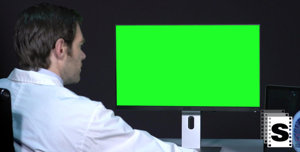 VideoHive Male Doctor Working With Green Screen 9709753