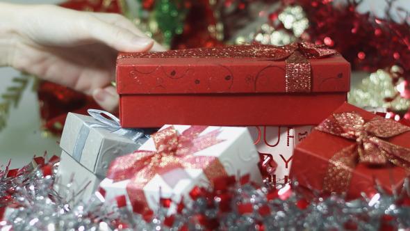 Hand Putting Gift Box