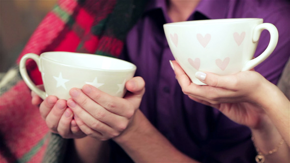 VideoHive A Loving Couple Holding Cups And Drinks At Christm 9713059