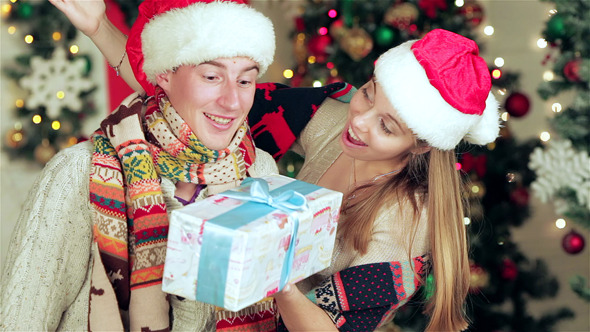 VideoHive Loving Couple Hold Christmas Presents 9713693