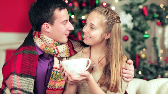 Young Beautiful Couple In Sweaters And Scarves