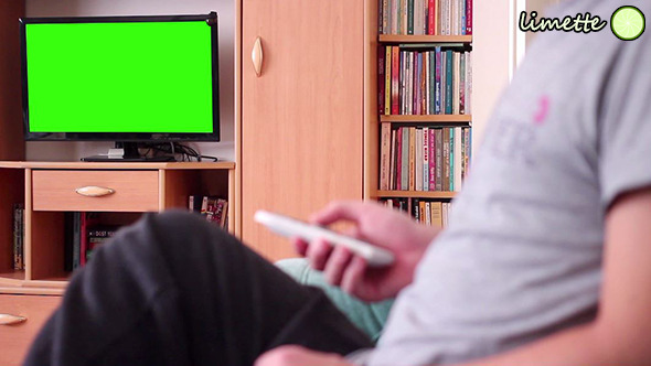 VideoHive Watching TV Green Screen 9714943