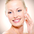 Portrait of healthy smiling woman touching face - PhotoDune Item for Sale