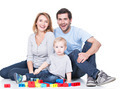 Smiling young family playing with a baby. - PhotoDune Item for Sale