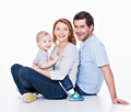 Happy young family with little child. - PhotoDune Item for Sale