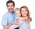 Portrait of the happy family with little child. - PhotoDune Item for Sale