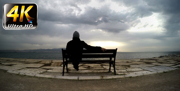 Man on a Seat Near the Sea 2