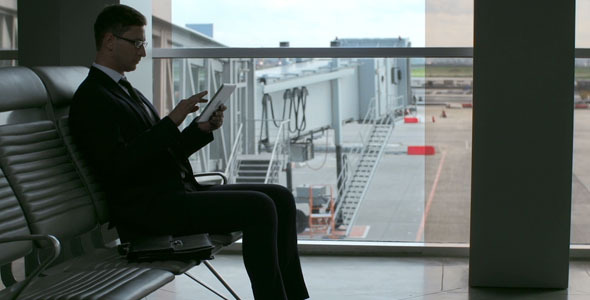 VideoHive Businessman in Airport Waiting Room 9719163