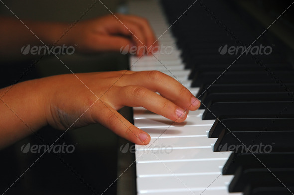 Child hands on a keyboard