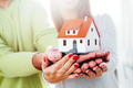 Hands holding a minature house - PhotoDune Item for Sale