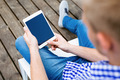 Relaxed man using digital tablet - PhotoDune Item for Sale