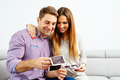 Young pregnant couple looking at an ultrasound scan - PhotoDune Item for Sale