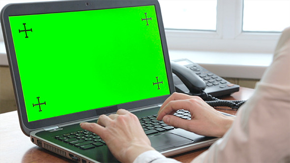 Woman Typing On Her Laptop with Green Screen