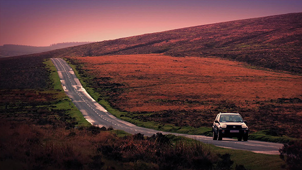 VideoHive Car Drives Down Hill In Early Morning 9724757