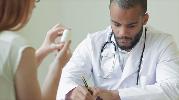 VideoHive Resolute Doctor Writes Diagnosis 9725417