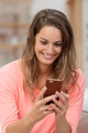 Pretty young woman reading a text message - PhotoDune Item for Sale