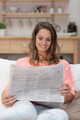 Young woman reading a newspaper - PhotoDune Item for Sale