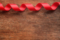 Red Ribbon on Old Wood Background - PhotoDune Item for Sale