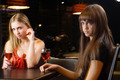 Young beautiful women drinking red wine in bar - PhotoDune Item for Sale