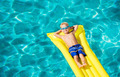 Young Kid Having Fun in Swimming Pool - PhotoDune Item for Sale