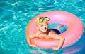 Young Kid Having Fun in the Swimming Pool - PhotoDune Item for Sale