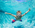 Young Boy Diving Underwater in Swimming Pool - PhotoDune Item for Sale