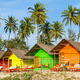 Colorful huts on the sandy beach with palm trees background in G - PhotoDune Item for Sale