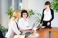 Pretty business lady makes presentation to her colleagues in office - PhotoDune Item for Sale