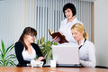 Three attractive businesswomen working with laptop at office - PhotoDune Item for Sale