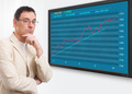 man and stock market graph on digital screen - PhotoDune Item for Sale