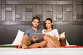 Young couple using a Tablet PC in a asian hotel room - PhotoDune Item for Sale