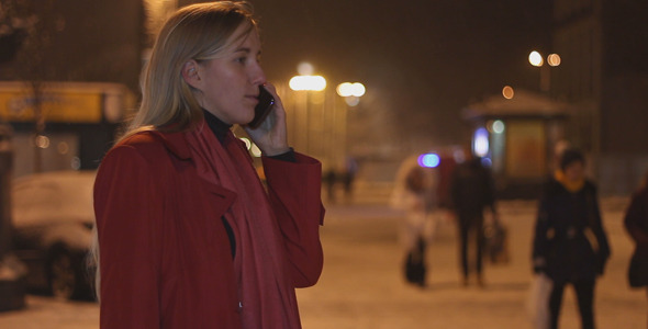 Woman Talking on the Phone in the Evening