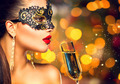 Sexy model woman wearing carnival mask with glass of champagne - PhotoDune Item for Sale