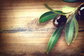 Olive over wood. Olives branch on the wooden table - PhotoDune Item for Sale