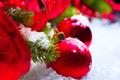 Christmas red baubles on snow background - PhotoDune Item for Sale