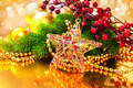 Christmas baubles and decorations over golden background - PhotoDune Item for Sale