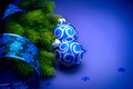 Christmas blue baubles with ribbon over blue background - PhotoDune Item for Sale