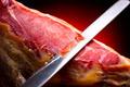 Jamon serrano. Traditional spanish ham. Slicing hamon iberico - PhotoDune Item for Sale
