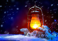 Christmas Holiday Scene. Burning Old Styled lantern in the eveni - PhotoDune Item for Sale