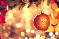 Christmas decoration. Golden bauble hanging on Christmas tree - PhotoDune Item for Sale