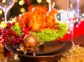 Christmas dinner. Holiday decorated table with roasted turkey - PhotoDune Item for Sale